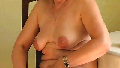 Sexy grandma probes her old pussy with a dildo