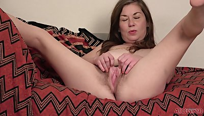 Nasty mature Olivia Johnson posing and masturbating solo helter-skelter lingerie