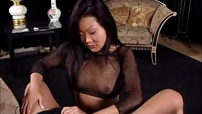 Seductive Asian cougar in fishnet stockings awarding her guy a superb handjob in a reality shoot