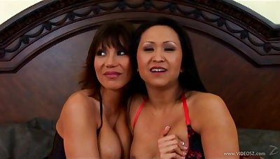 Guileful Asian milfs in fishnet stockings undergo a fat cock