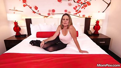 Skinny brunette milf alongside saggy tits, Judith, is riding a hard white cock for a camera