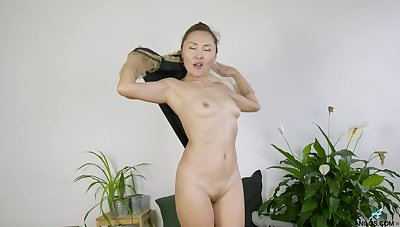 Amateur slattern Lira Kissy loves undressing and flashing with her pussy