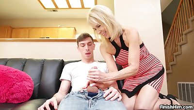 Sassy stepmother Erica Lauren gives young hung descendant a handjob