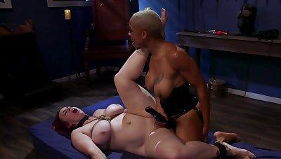 Negro mistress is strap-on fucking her secured up slavegirl
