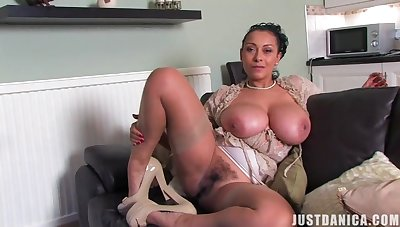 Horny matchless wife Danica Collins plays with her giant boobs and cunt