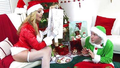 Offbeat fucking between an elf and naughty Ms. Claus Julia Ann