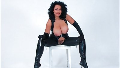 Perverse MILF Danica Collins in leather flashing her tits and cunt